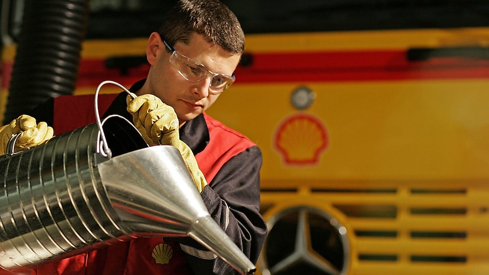 shell employee pouring lubricants Oil