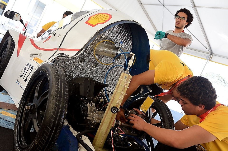 Team members work on the Anubis, #512, UrbanConcept, competing for team CUT Eco-Racing UC from Cairo University Faculty of Engineering , Egypt during day two of the Shell Eco-marathon in Manila, Philippines, Friday, Feb. 27, 2015.